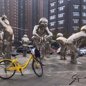 "Original ""Laughing Men"" sculpture, Beijing."