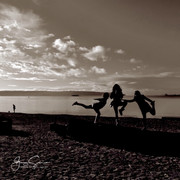 People tableau, sunset at English Bay.