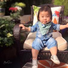 Sitting in a big chair.