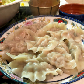 Chinese dumplings cooked in boiling water.