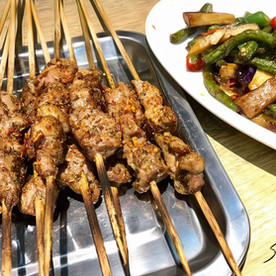 Barbecued lamb and spicy beans.  China.