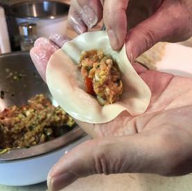Making Chinese dumplings.