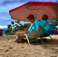Relaxing on the beach at Napili Bay, Maui.