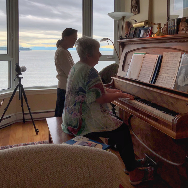 Singing and playing the piano.  West Vancouver home.