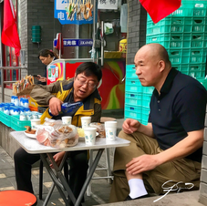 Lunch on the sidewalk, Beijing.