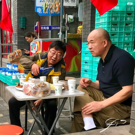 Lunch on the sidewalk, Beijing.