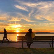 Busy seawall at English Bay at sunset.  Vancouver.