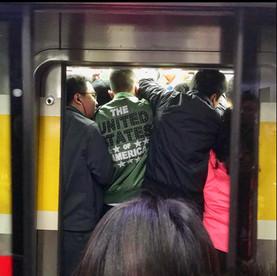 Crammed subway, rush hour, Beijing.