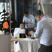 Brave boy getting a haircut.  Beijing.