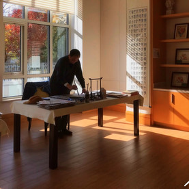 Man practising the ancient art of Chinese calligraphy.