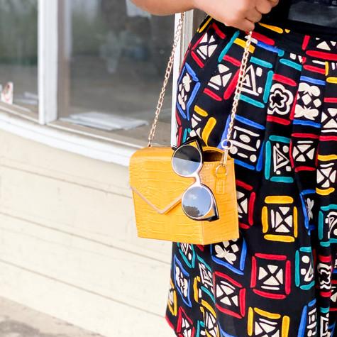 Styling Cat-eye rim shades and Croc Crossbody bag