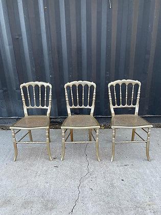 Chaise Napoleon en bois et cannage dorés