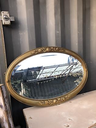 Miroir doré ancien oval biseauté