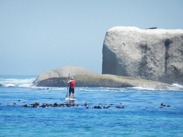 man on paddleboard in ocean