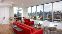 Red-Sofa-Idea-In-Stunning-Long-Island-City-Apartment-Interior-Feat-Modern-Rocking-Chair-And-Round-Gl