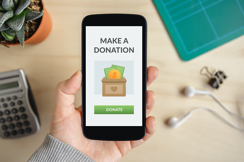 Hand holding smart phone with donate con