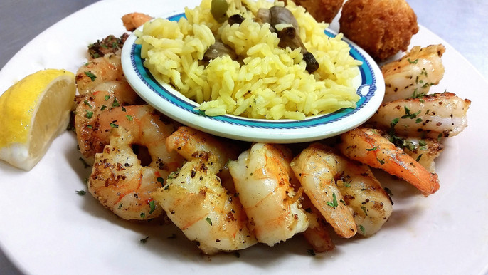 Everyone loves our jumbo shrimp! Shown grilled with yellow rice pilaf.