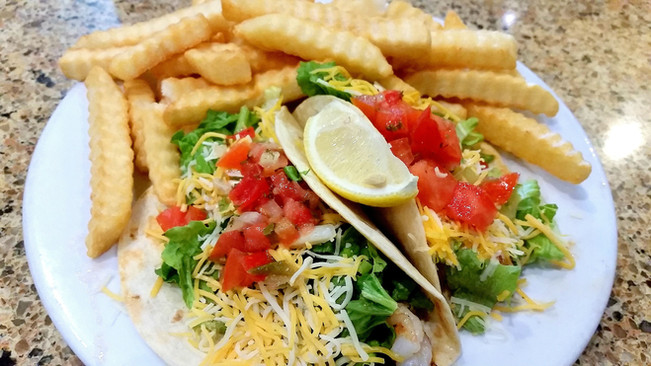 Have your tacos with shrimp or mahi, fried, grilled, or blackened and topped high with lettuce, cheese, home made pico de gallo and a drizzle of our secret spicy sauce!