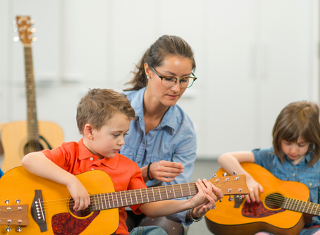Should 5 year olds be taught to play guitar? Absolutely!