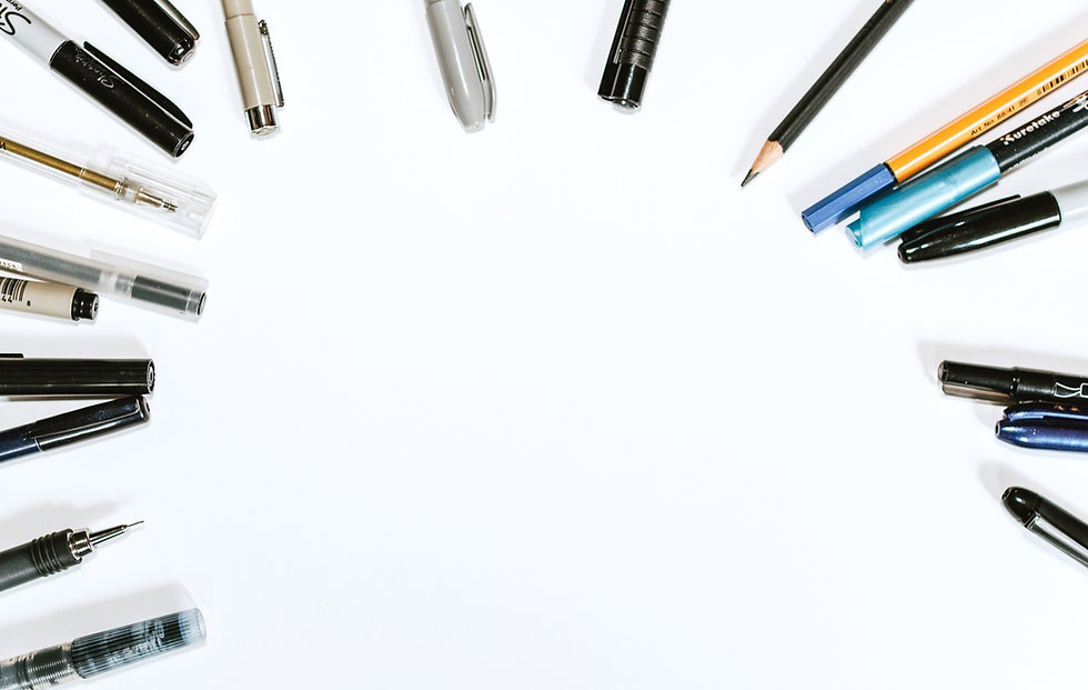 assorted pens on white surface_edited.jpg