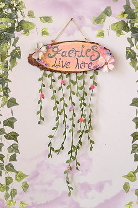 Faeries Live Here pink wooden sign