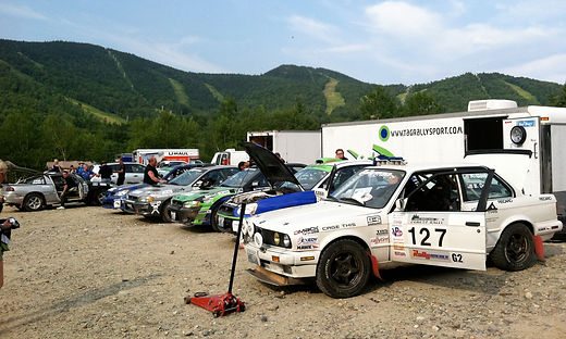 The Slapdash E30 BMW at the base of the mountains at Sunday River Ski Resort.
