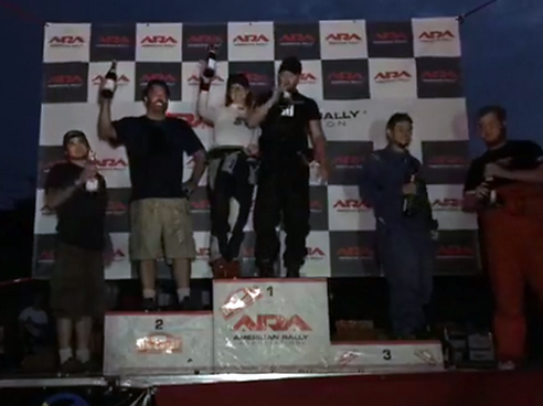 Slapdash Racing on the podium with champagne spray.
