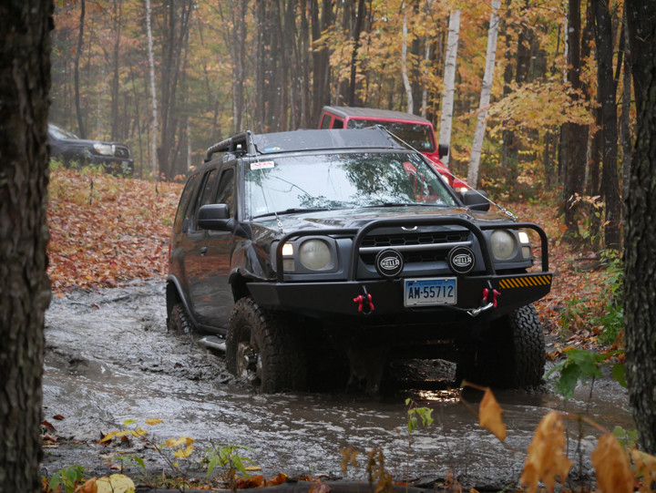 Xterra coming out of mud puddle.