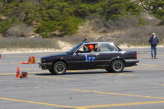 Black E30 1988 BMW 325is at an AutoCross course.