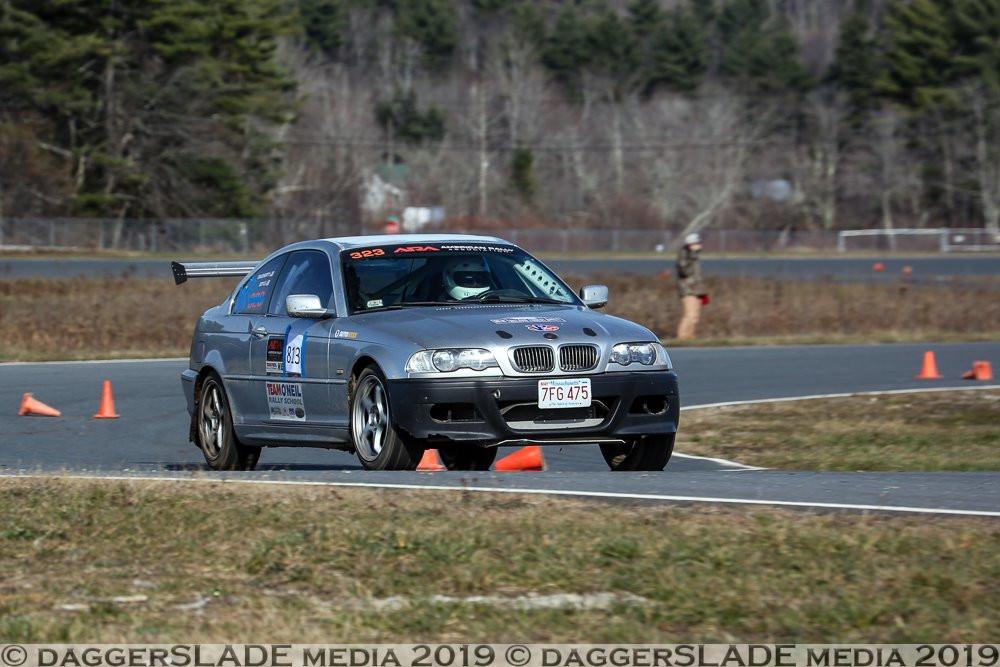 E46 BMW rally car being driven around a RallyCross course.