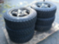 A stack of six, brand-new rally tires. Ahh, smell the fresh rubber!