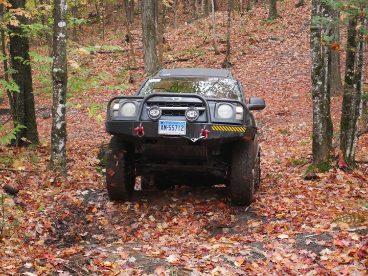 Muddy Xterra climbing out of the Monster Mogul.