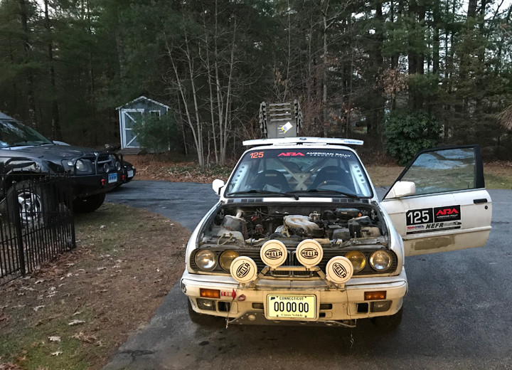 White E30 1988 BMW 325is Rally Car in need of repairs.