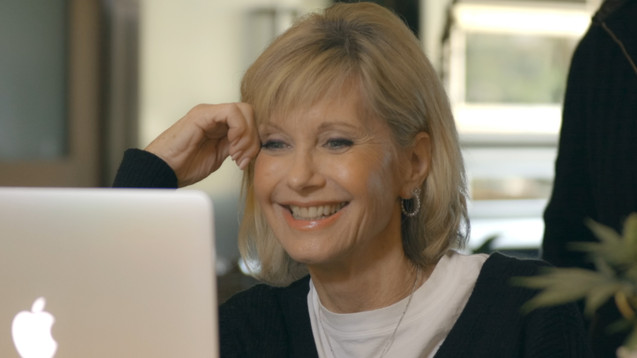 Olivia Newton-John,  skyping with Mike .