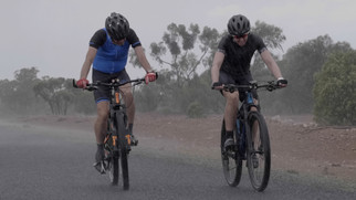 Mike & Sam Getting drenched on the Old Wool Track, Cobar