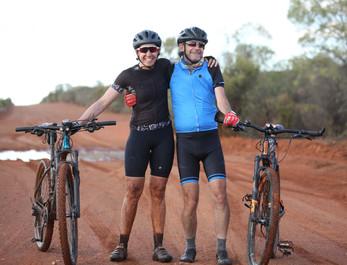 Mike and Sam after the Mud run at cobar.