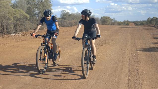 Mike & Sam Imn the red dirt at Cobar.jpg