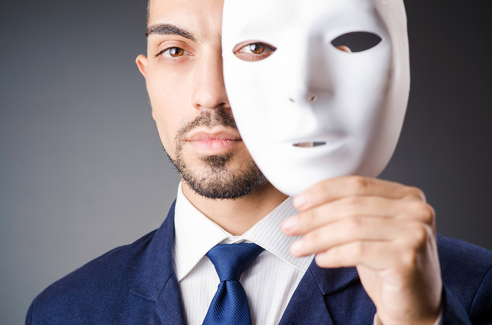 hiding behind a mask, mask, young man, impostor syndrome