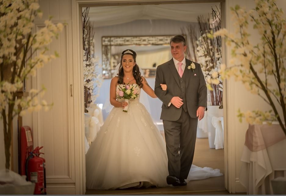 bride and father walk down the aisle