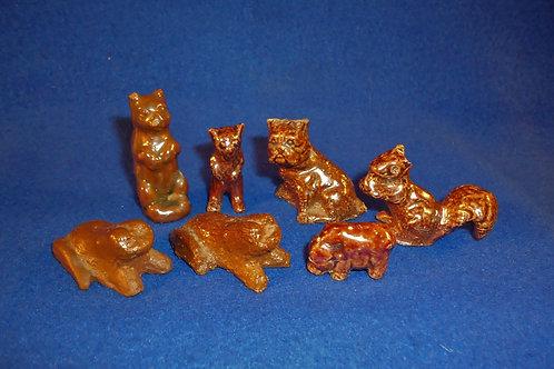 7 Sewer Tile Miniature Figurals for 1 Money