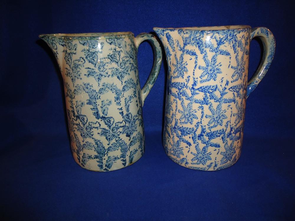 two cut antique spongeware pitchers