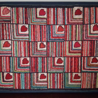 Vibrant hooked rug with hearts!