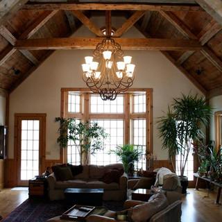 Living room renovation using reclaimed barn wood beams