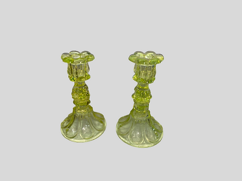 Pair of canary yellow sandwich glass candle sticks