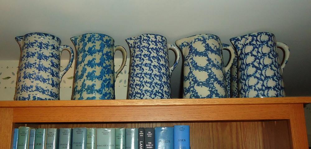 five antique spongeware pitchers