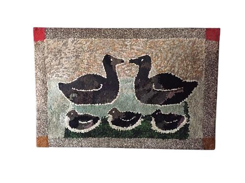Hooked rug of ducks