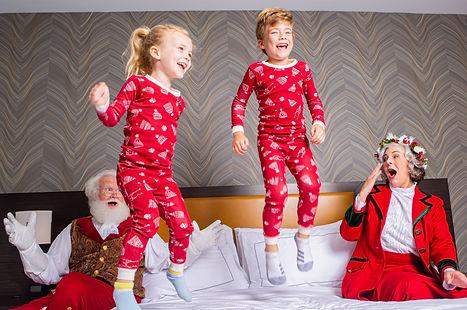 kids jumping on bed, santa astonished