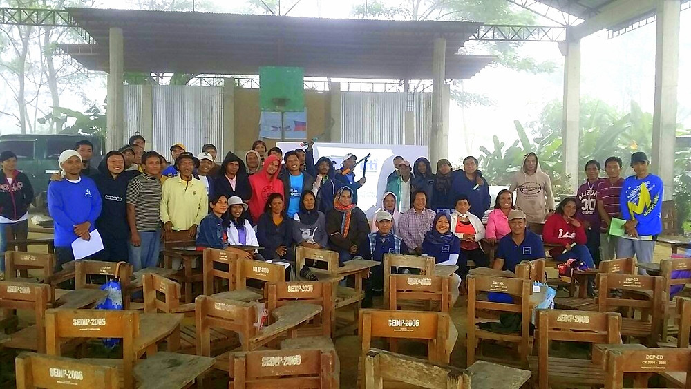 Photo op after a foggy, rainy, windy training afternoon with our smiling farmers.