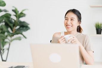 beautiful-young-smiling-asian-woman-work