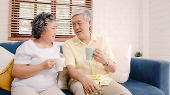 asian-elderly-couple-drinking-warm-coffe